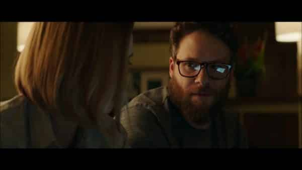 Fred (Seth Rogen) talking to Charlotte.