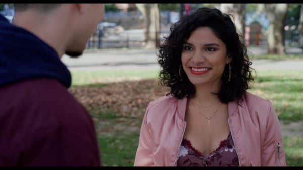 Lulu (Shakira Barrera) smiling at Malcolm.