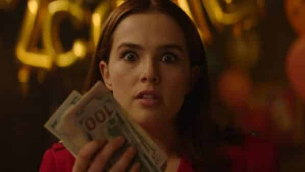 Peg (Zoey Deutch) holding hundreds of dollars.
