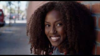 Rosa (Jade Eshete) smiling.