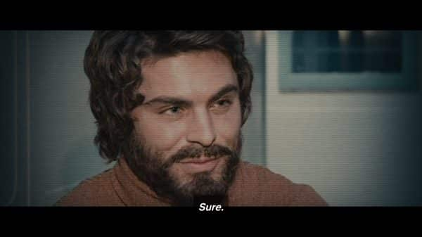 Ted Bundy (Zac Efron) during a interview with a well shaped beard.