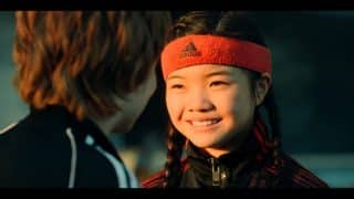 Zhenzhen (Miya Cech) smiling at Alex (Jack Gore)