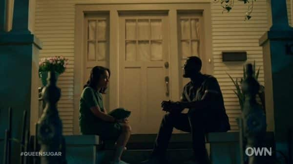 Darla and Ralph Angel talking on a stoop.