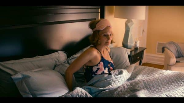 DeDe (Barbara Garrick) getting out of bed.