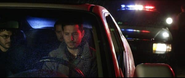 Dominic (Jay Habre), Bobby (Joseph Martinz), and Eagle (Sean Nateghi) in a car together, being pulled over.