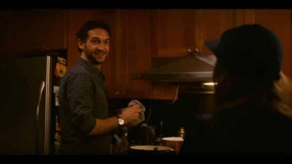 Eli (Benjamin Thys) cooking dinner.