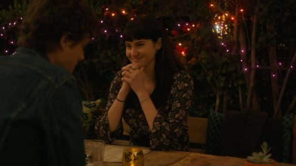 Jane smiling during her date with Corey.