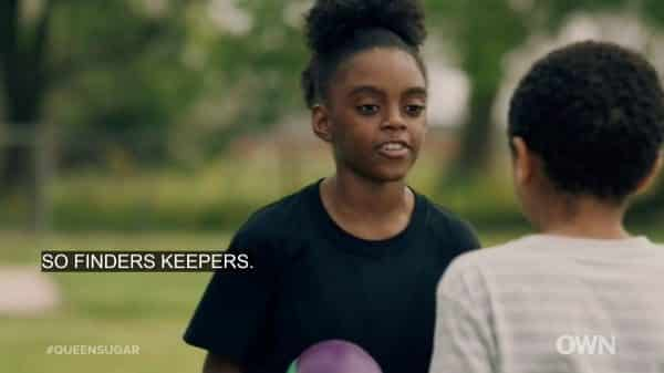 Joie (Kendall Denise Clark) trying to take Blue's football.
