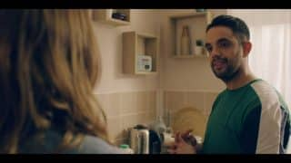 Jonjo (George Bukhari) in Rosie's kitchen.