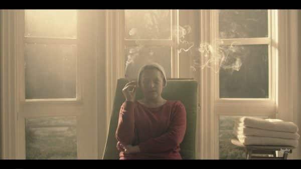 June smoking a cigarette Serena gave her.