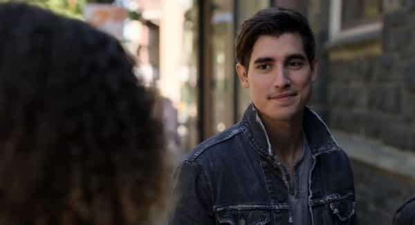 Luca (Henry Zaga) talking to Tabitha.