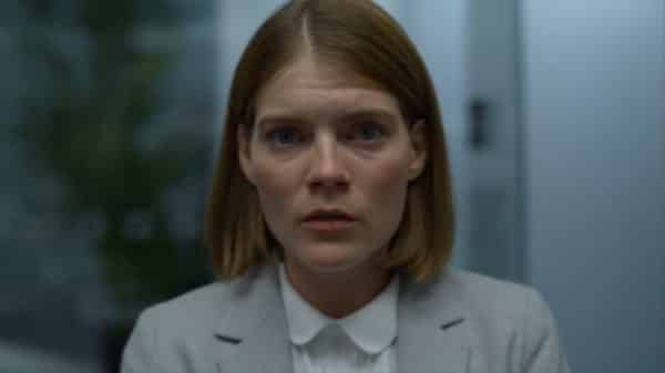 Myfanwy (Emma Greenwell) as she realizes she is in the room with a traitor.