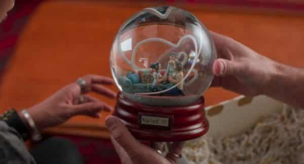Celia's gift of a snow globe featuring Andi, Bowie, and Bex when the proposal happened.