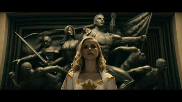 Annie aka Starlight (Erin Moriarty) in front of a statue of The Seven.