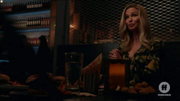 Bonnie (Reagan Pasternak) at dinner with Dennis and Davia