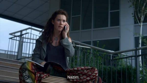 Bronwyn (Tamsin Topolski) talking on the phone.