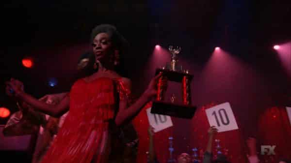 Candy accepting her trophy.
