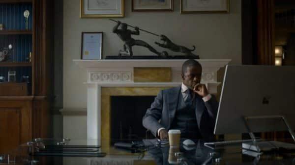 Conrad sitting at a computer.