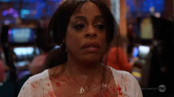 Desna (Niecy Nash), covered in blood, exhausted, and just wanting to go home.
