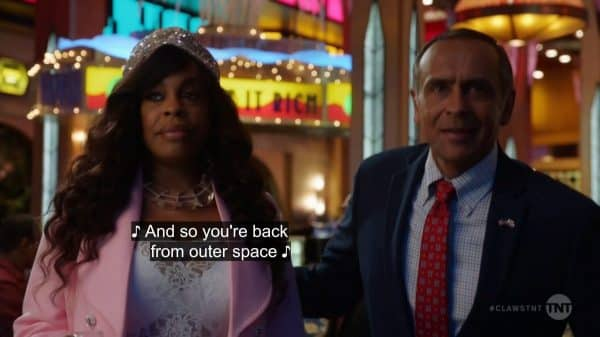 Desna and Governor Patel (Bernard White) entering the casino floor.