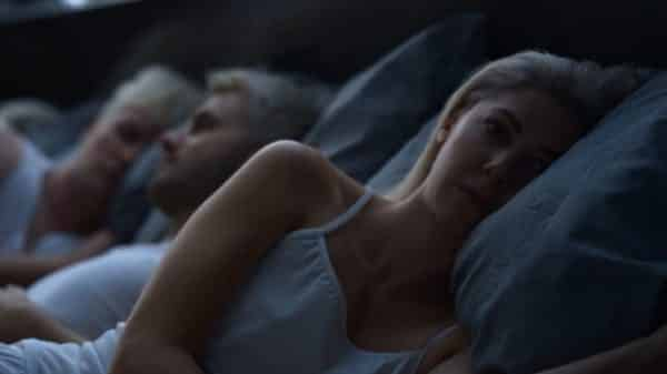 Eliza waking up with her brothers.