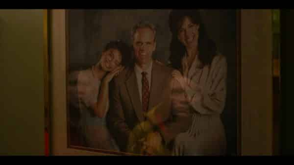 Heather (Francesca Reale), Tom (Michael Park) and Tom's wife in a family portrait.