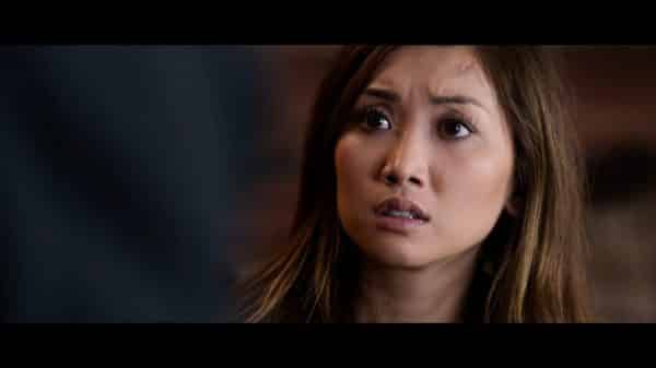 Jennifer (Brenda Song) looking shocked.