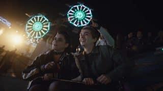 Kat & Ethan (Austin Abrams) on a roller coaster.