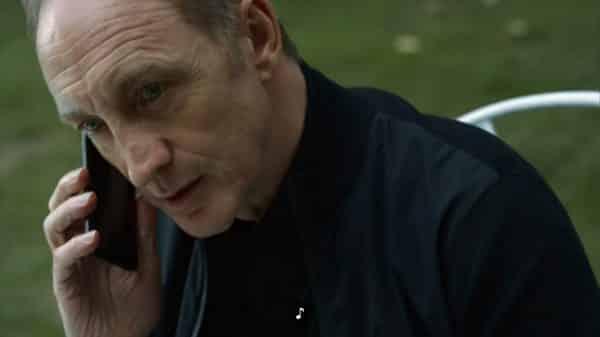 Lorik (Michael McElhatton) on the phone.