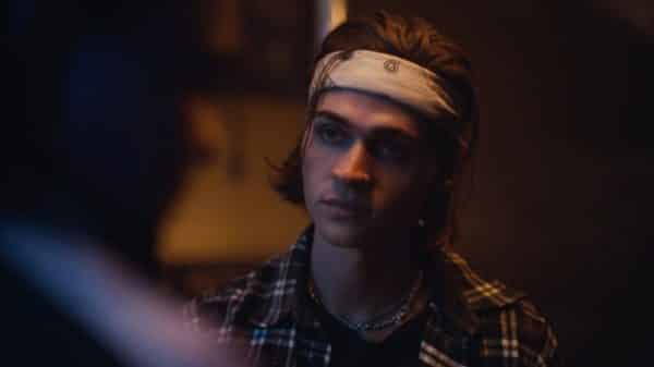 Luke (Will Peltz) chatting with Kat before they have sex.