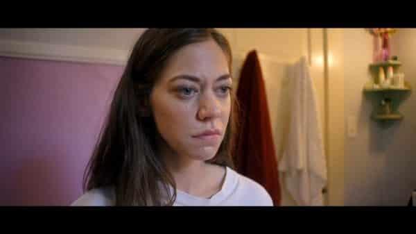 Mel (Analeigh Tipton) looking upset.