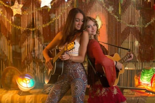 Meryl (Meg Delacy) and Lorian (Willow Shields) performing together.