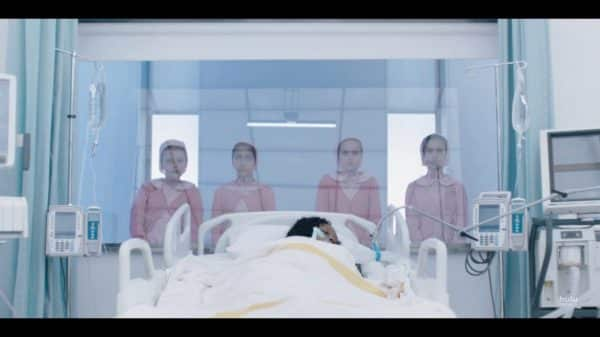 Natalie in a coma, with four children ominously behind her.