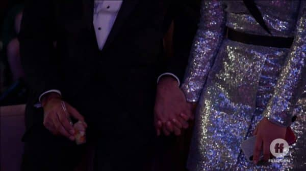 Raj and Mariana holding hands.