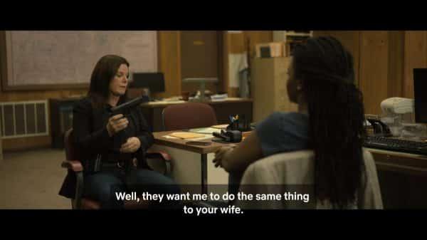 Regina (Marcia Gay Harden) with Paul's wife, threatening to kill her.