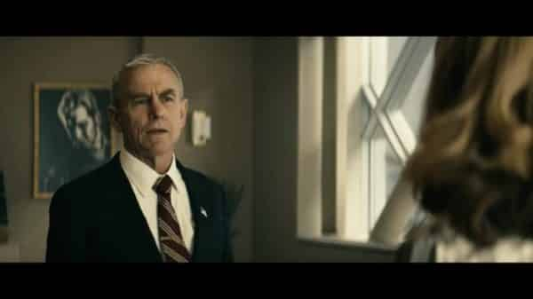 Senator Calhoun (David Andrews) learning he is being blackmailed.
