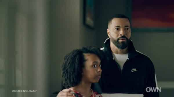 Tia (Mikari Tarpley) and Davis reacting to Charley.