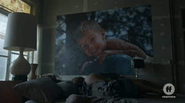 Dennis with a mosaic of his son on his wall.