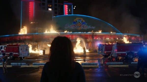 Desna watching the casino burn.