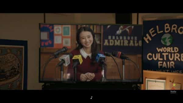 Erica (Annie Q.) having a press conference after surviving.