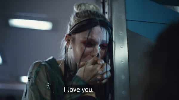 Jules kissing Rue's hand as she leaves on a train.