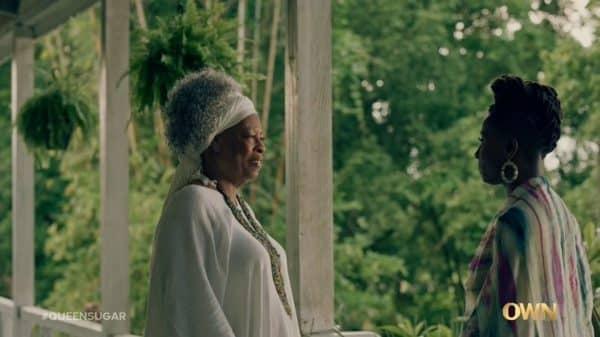 Miss Martha (Carol Sutton) and Nova speaking at Miss Martha's house.