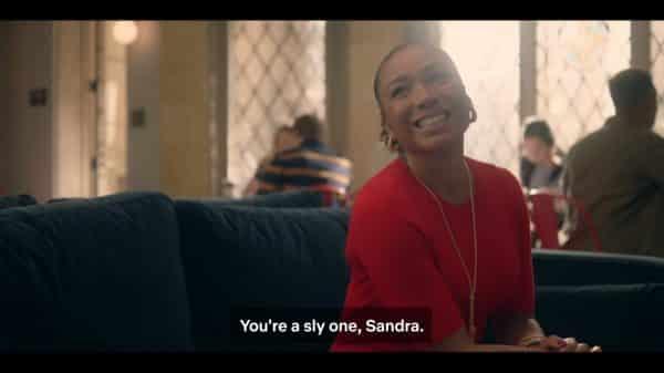 Sandra (Eva La Dare) smiling at Dean Fairbanks.