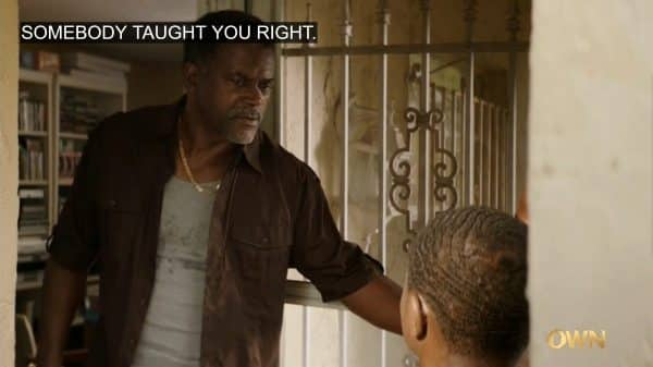 Saul (Darryl W. Handy) hanging out his door, talking to Dave.
