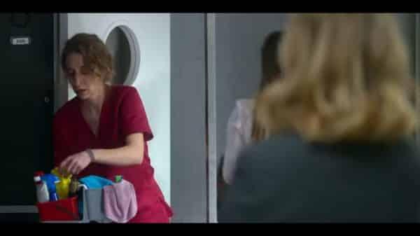 Victoria (Marta Aledo) prepping to clean a room.
