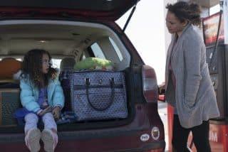 Clara (Apollonia Pratt) and Katrina (Carmen Ejogo) at a gas station.
