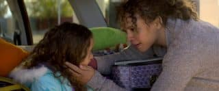 Katrina (Carmen Ejogo) holding Clara's (Apollonia Pratt) face in her hands.