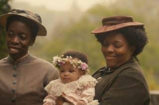 Constance (Lisa Codrington), Delphine, and Jocelyn (Nicky Lawrence) at the Easter celebration.