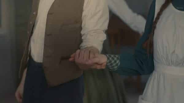 Gilbet and Anne holding hands