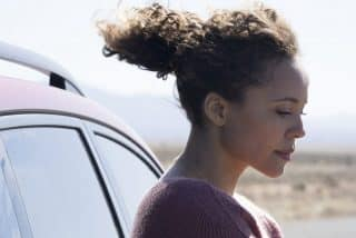A side profile of Katrina (Carmen Ejogo).